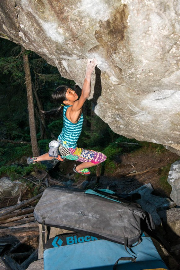 Ashima bouldering in Magic Wood. Photo by Rainer Eder.